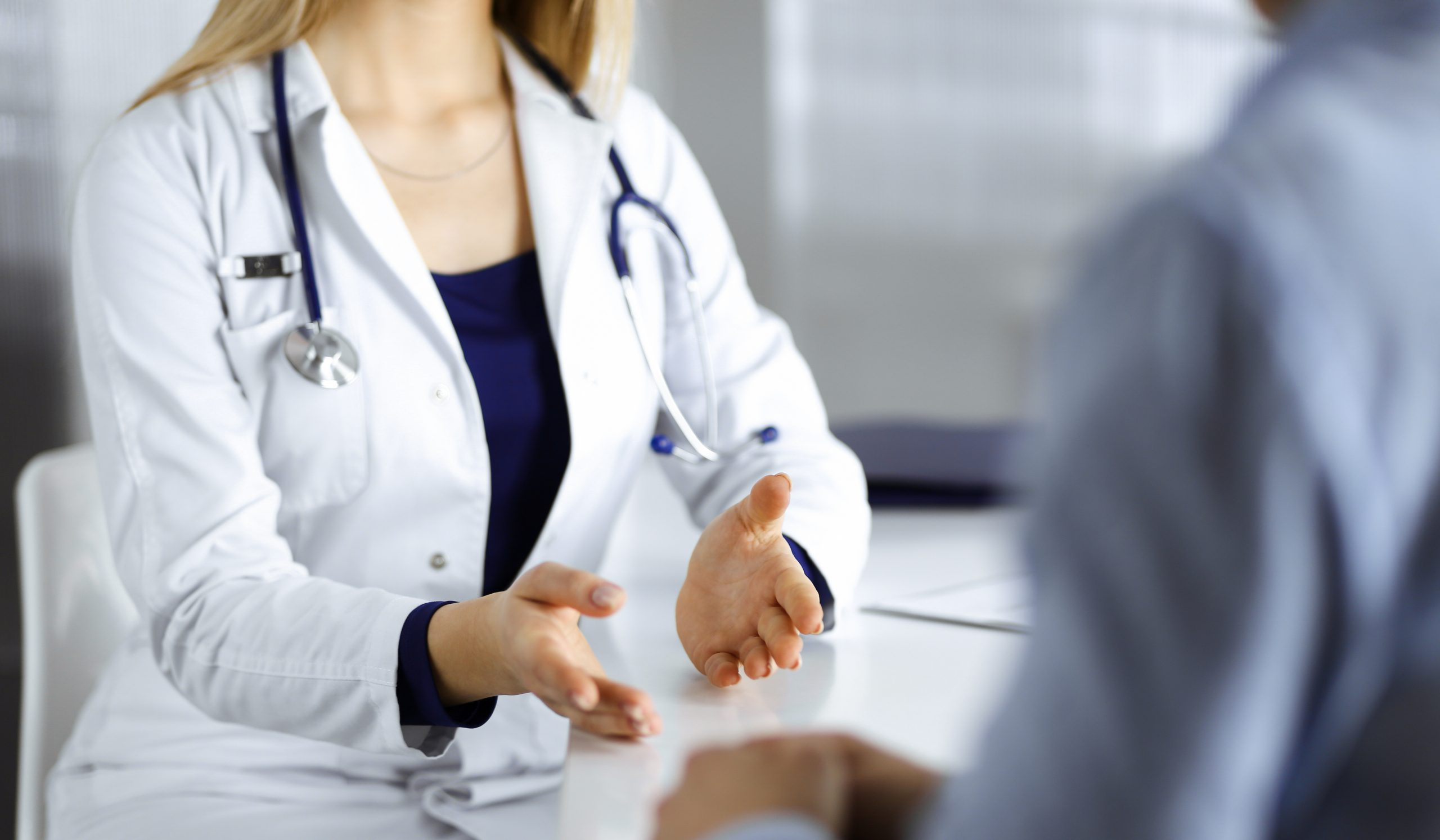 Woman talking to her doctor about abortion care.